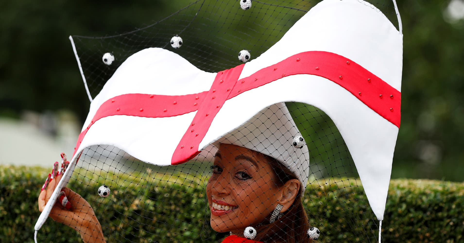 Hat designer Tracy Rose poses before the start of racing at the Royal Ascot with a World Cup inspired creation supporting England.