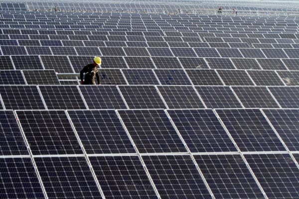 Workers install solar panels at the construction site of 40MW photovoltaic on-grid power project of China Huaneng Group on June 13, 2018 in Huai an, China.