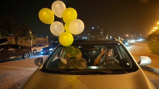 A Saudi woman and her friends celebrate her first time driving on a main street of Khobar City on her way to Kingdom of Bahrain on June 24, 2018. Saudi Arabia will allow women to drive from June 24, ending the world's only ban on female motorists.