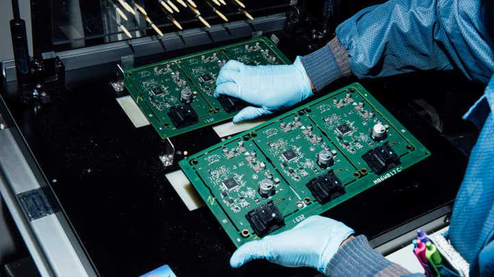 A technician moves electronic components at Magna International in Holly, Michigan. Magna helps steer automakers through the stages of design, engineering and assembly.
