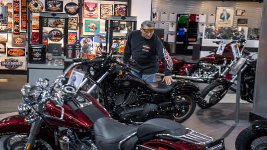 A customer looks at a motorcycle on display at the Oakland Harley-Davidson dealership in Oakland, California, U.S., on Friday, April 14, 2017.