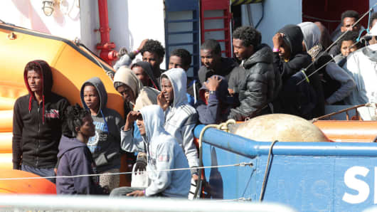 Migrants waiting to disembark on the island of Sicily on April 24, 2018.
