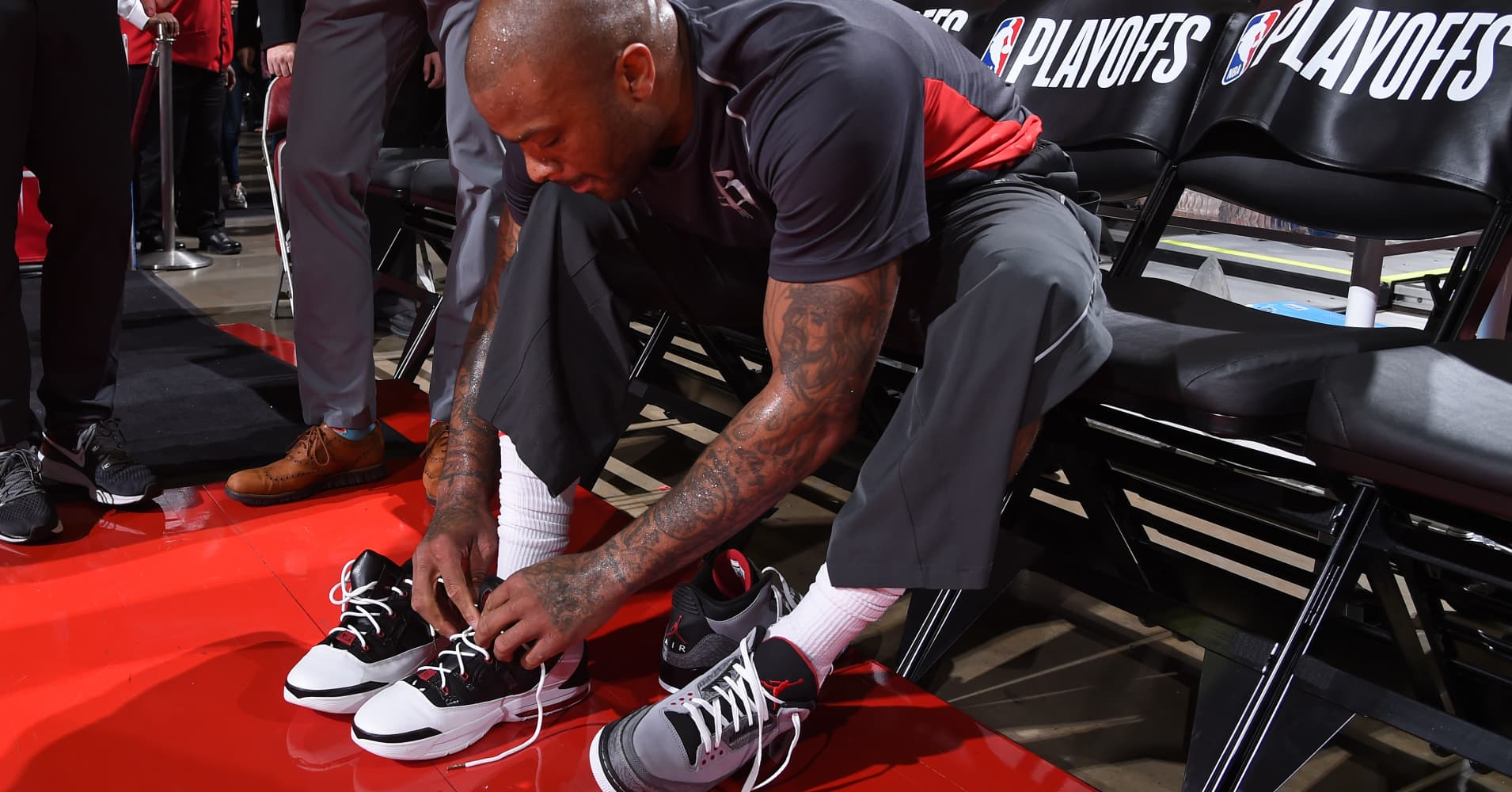 84bcde6b440 PJ Tucker of the Houston Rockets switches his sneakers before Game One of  Round One of