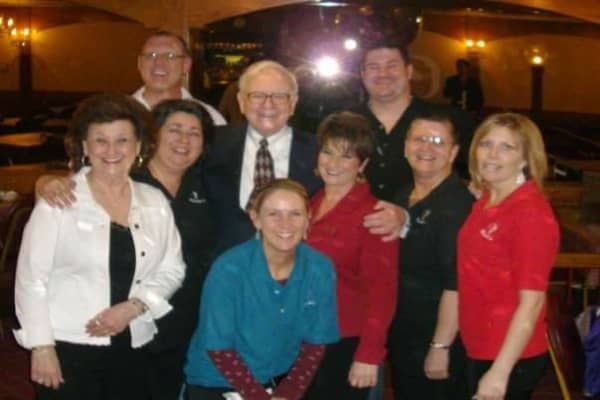 Piccolo's waitress Ellen Augustine (front center) pictured with Warren Buffett (back center) and Piccolo's former owners Dee Graves (left) and Donna Sheehan (right) in 2009.
