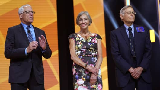 Members of the Walton family (L-R) Rob, Alice and Jim speak during the annual Walmart shareholders meeting event on June 1, 2018 in Fayetteville, Arkansas.