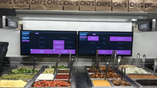 Digital orders come through a second-make line at Chipotle stores via flat screen TVs.