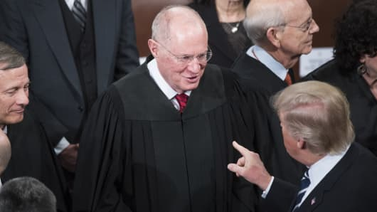 President Donald Trump greets Supreme Court Justice Anthony Kennedy after addressing a joint session of Congress in the Capitol's House Chamber, February 28, 2017.