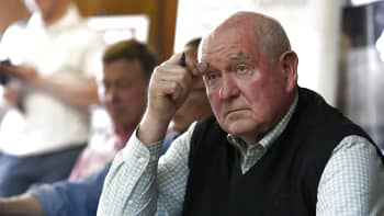 United States Secretary of Agriculture Sonny Perdue, right, listens during a round table discussion with local Colorado vegetable growers on May 15, 2018 in Brighton, Colorado.  U.S. Agriculture Secretary Sonny Perdue is visiting Colorado as part of a tour highlighting Trump administration priorities on support for farmers and food stamps.