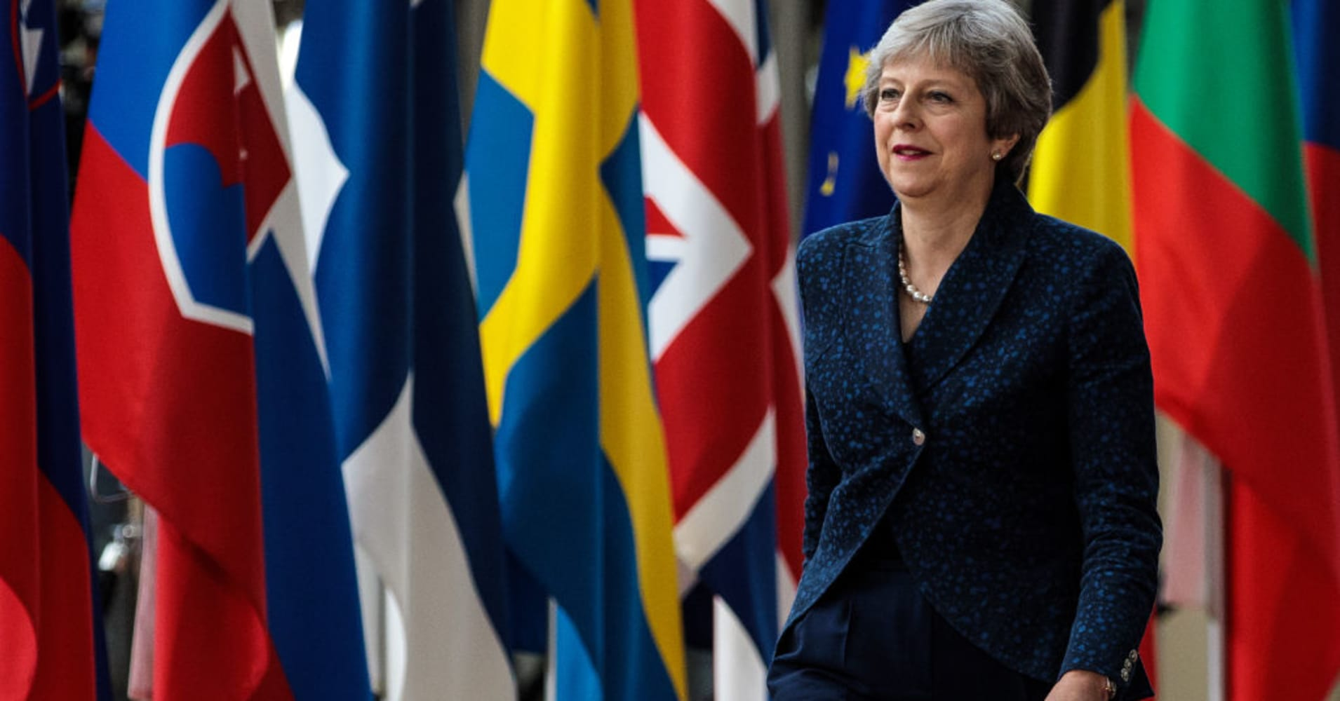 Under pressure to soften Brexit plans, Theresa May signals faster pace