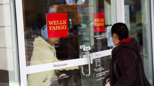 A customer exits a Wells Fargo & Co. bank branch in Los Angeles Patrick T. Fallon/Bloomberg via Getty Images
