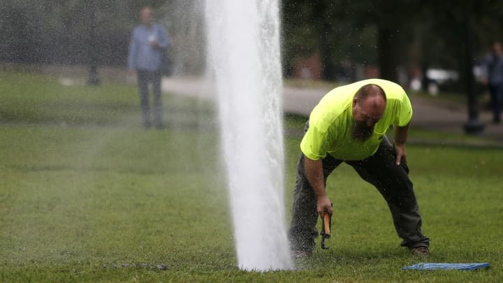 A broken valve causes water to spew into the air on the Boston Common.