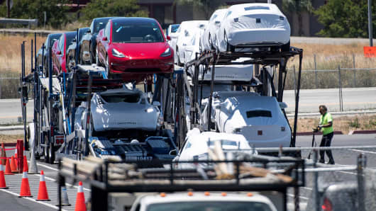 Tesla Model 3 vehicles are loaded onto a truck for transport at the company's manufacturing facility in Fremont, California, on Wednesday, June 20, 2018.
