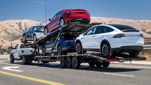 Tesla vehicles are transported on a truck after leaving the company's manufacturing facility in Fremont, California, on Wednesday, June 20, 2018.