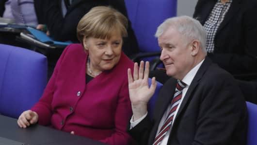 German Chancellor Angela Merkel speaks to Interior Ministry, Horst Seehofer