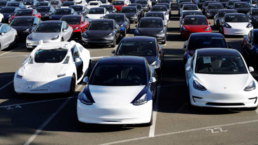 A parking lot of predominantly new Tesla Model 3 electric vehicles is seen in Richmond, California, U.S. June 22, 2018.
