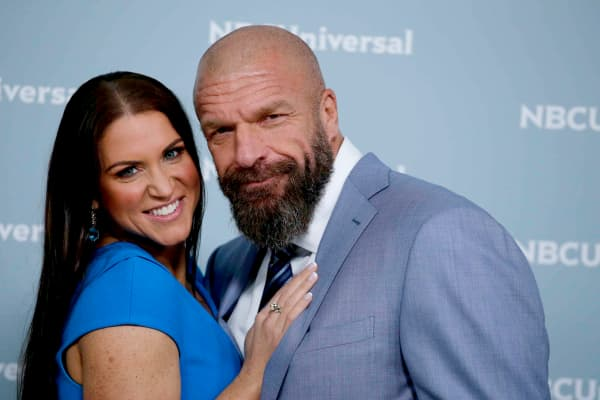 Chief brand officer of WWE Stephanie McMahon (L) and Triple H (R)