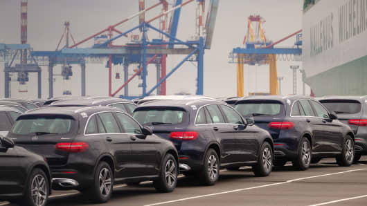 Mercedes-Benz cars wait to be shipped at the harbor in Bremerhaven, nothern Germany, on June 1, 2018.
