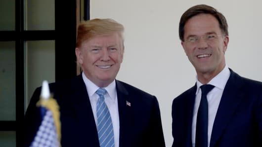President Donald Trump welcomes Dutch Prime Minister Mark Rutte (R) to the White House July 2, 2018 in Washington, DC.