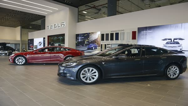CFRA downgrades Tesla, says production rate not financially sustainable