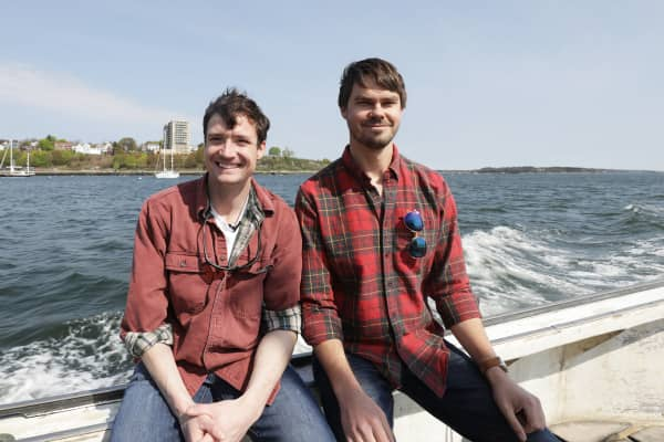 Co-founders Luke Holden and Ben Conniff on a fishing vessel off the coast of Maine.