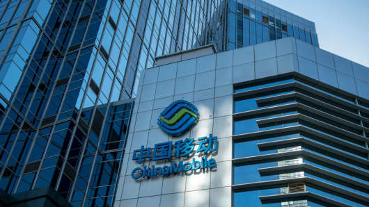 The logo of telecommunications company China Mobile is seen on a building in Beijing, China.
