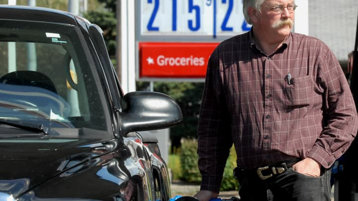 Dave Scott fills his truck with gasoline at a GasAmerica sta