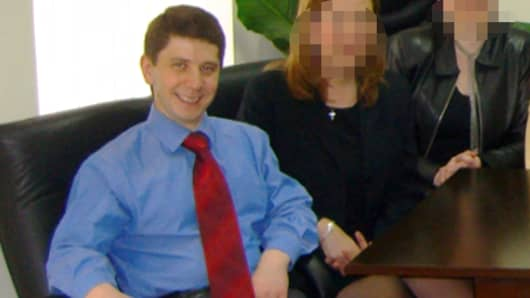 Konstantin Kilimnik, an elusive figure under indictment for alleged witness tampering by Special Counsel Robert Mueller, is seen seated on the far left in a March 2006 photo.