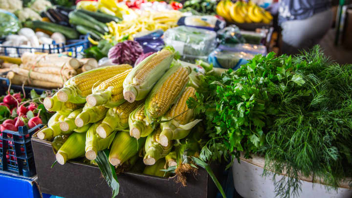 Various fruits and vegetables on the farm market in the city. Fruits and vegetables at a farmers market
