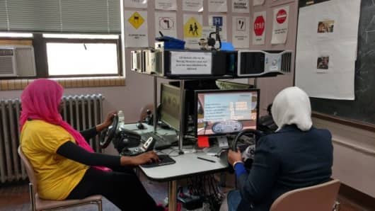 Immigrant women train on driving simulators at the Mohawk Valley Community College outside Utica, New York