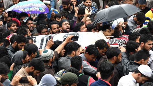 Kashmiri villagers carry the body of a youth, Faizan Ahmed, 15, during a funeral in Pampore on June 30, 2018. One suspected militant and a youth were killed during a gunfight in a protest in Pulwama, south of Srinagar, on June 29.