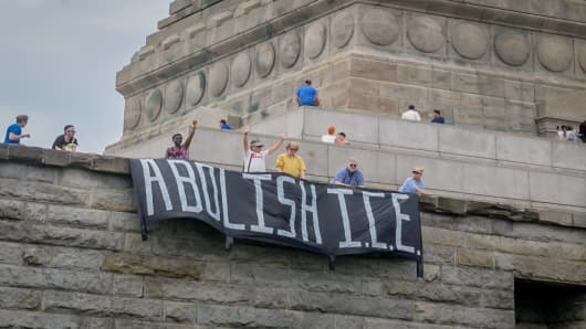 Reflecting the sentiments of last weeks nationwide End Family Separation protests, members of Rise and Resist planned and executed a non-violent banner drop and human banner action at the Statue of Liberty on Independence Day. An ABOLISH ICE banner was hung, and activists spelled out the same message on their shirts.