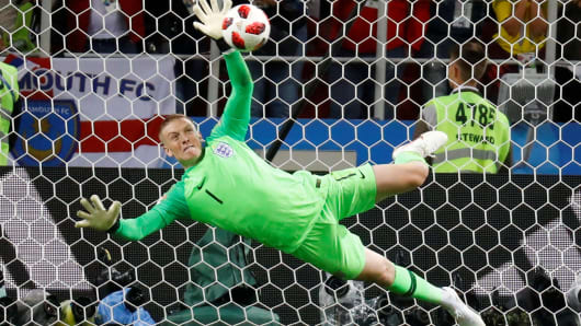 England's Jordan Pickford saves a penalty during the shootout from Colombia's Carlos Bacca.