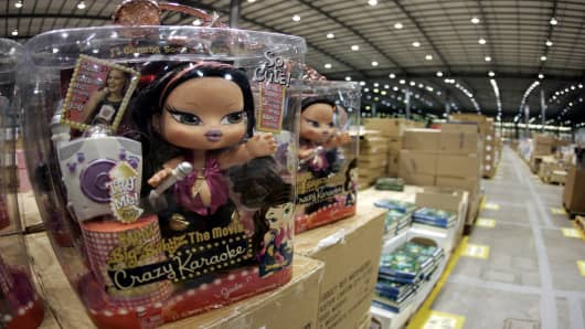 A Bratz doll sits on a shelf in the Amazon distribution centre.
