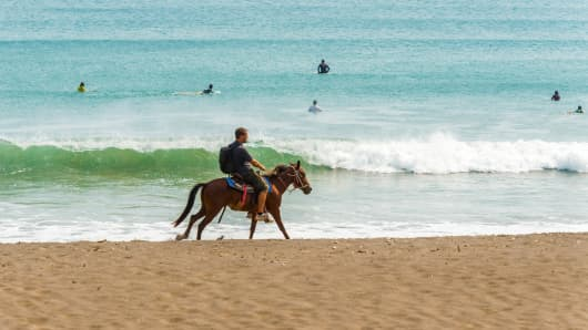 Man on the horse in Playa Venao near town of Pedasi in Panama.