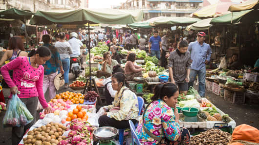 Local people shop in a traditional market in Phnom Penh, Cambodia capital city.