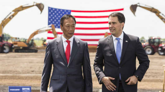 Foxconn CEO Terry Gou (L) and Wisconsin Gov. Scott Walter talk before the groundbreaking of the 1,000-acre Foxconn Technology Group  liquid-crystal display panel factory on June 28, 2018, in Mt. Pleasant, Wisconsin.