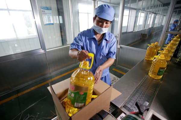 A worker packs bottles of soybean oil made from U.S. imported soybeans at the plant of Liangyou Industry and Trade Co., in Qufu, China, July 4, 2018.