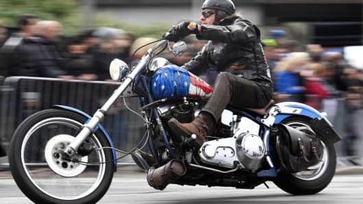 A biker rides a Harley Davidson