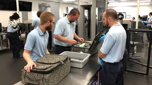 TSA trainees are taught how to use the X-ray machine, follow protocol and interact with passengers.