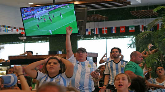 Fans of Argentina's national soccer team react to the 2018 World Cup match between Argentina and Croatia.
