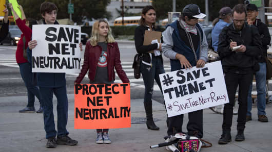 Supporters of net neutrality protest outside a Federal Building in Los Angeles, California on November 28, 2017.