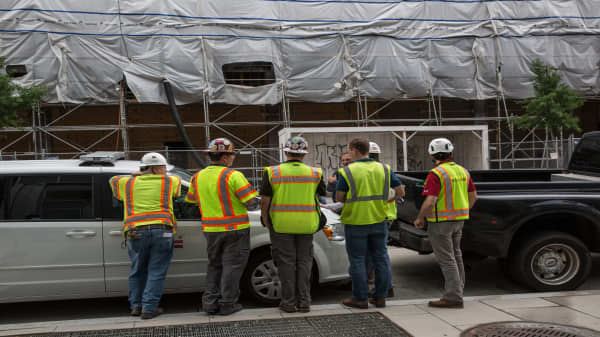 A group of construction workers congregate on the street in downtown on June 4, 2018 in Washington, D.C.
