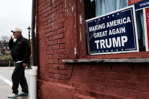 A Donald Trump sign hangs in the window in the town of Waynesburg, Pennsylvania. Waynesburg, once a thriving coal industry center, has struggled to find its footing in the new energy era.