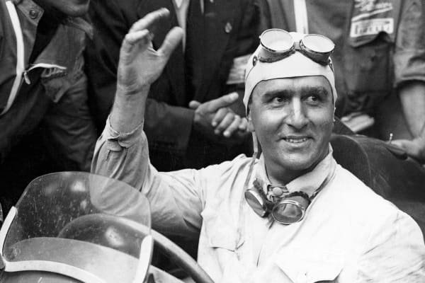 Italian racer Giuseppe Farina wins the world's first Formula One Grand Prix in 1950.