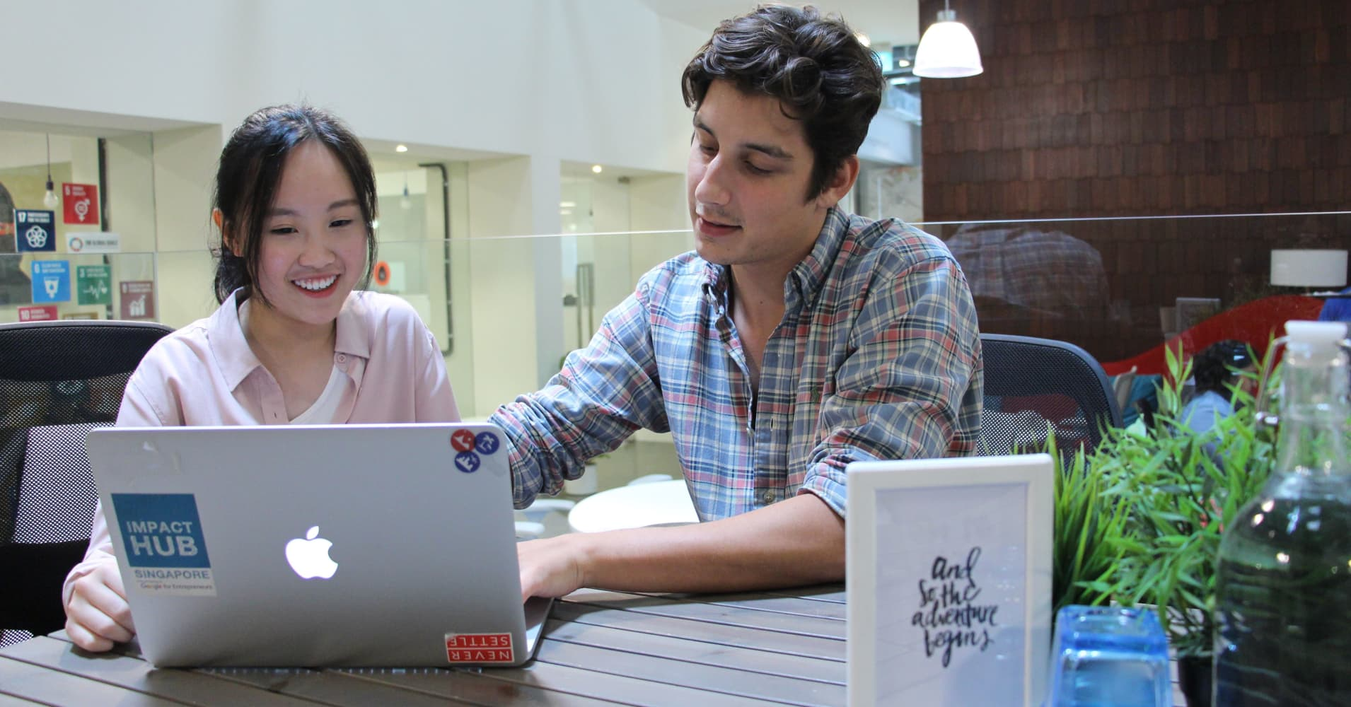 A woman is advised by Ben Fowler, at a startup program in Singapore