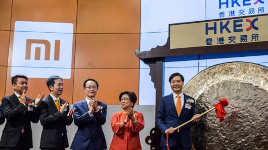 Xiaomi founder, chairman and CEO Lei Jun hits a gong at the company's initial public offering launch on the Hong Kong Stock Exchange on July 9, 2018.