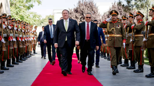 Secretary of State Mike Pompeo is greeted by Chief of Staff Abdul Salam Rahimi, as he arrives at Gul Khanna in the Presidential Palace in Kabul, Afghanistan, Monday, July 9, 2018.