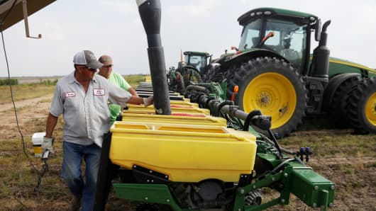A farmer fills seed planters with soybean seed in Gideon, Missouri.