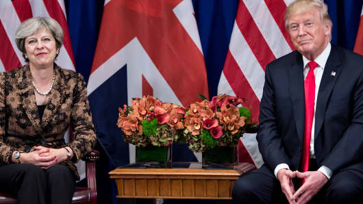 British Prime Minister Theresa May and US President Donald Trump wait for a meeting at the Palace Hotel in New York.