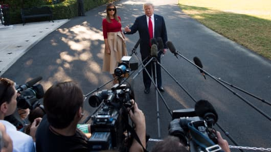 US President Donald Trump speaks to the media alongside First Lady Melania Trump as they walk to Marine One prior to departure from the South Lawn of the White House in Washington, DC, July 10, 2018, as they travel on a week-long trip to Europe, with stops in Brussels, London, Scotland and Helsinki. (Photo by SAUL LOEB / AFP)        (Photo credit should read SAUL LOEB/AFP/Getty Images)